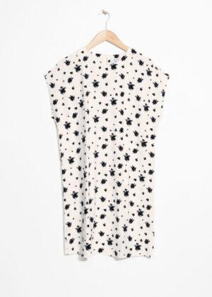 Vit t-shirt-klänning med dragkedja till billigt pris.