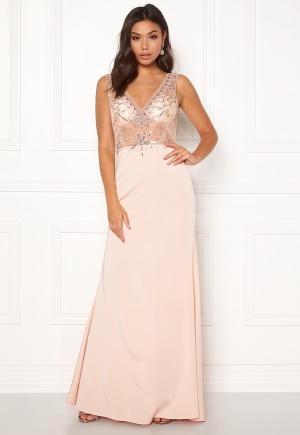 Lång maxiklänning med v-ringning. Klänningen är beige och riktigt snygg.