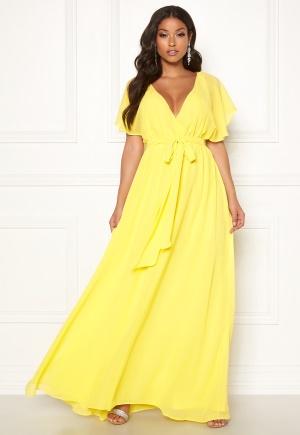 Klassisk gul omlottklänning.