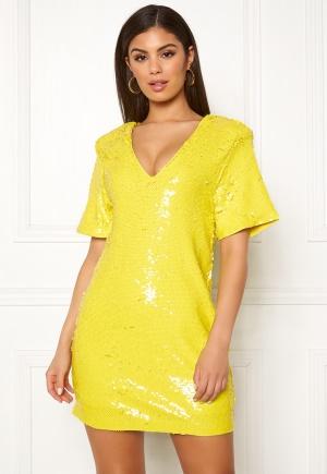 Läcker gul stretchig klänning i paljetter.