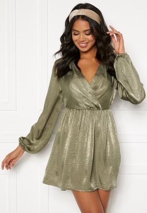 Klassisk grön miniklänning.