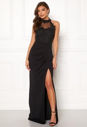 Sexig svart stretchig klänning från Moments New York med dragkedja.