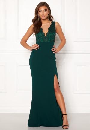 Lång stretchig klänning med v-ringning. Klänningen är grön och modemedveten.