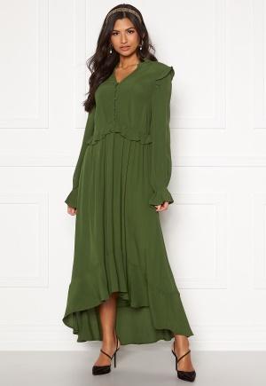 Fin grön blommig klänning.