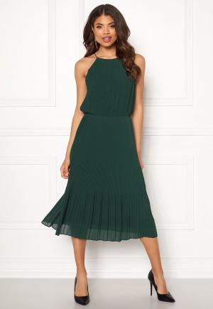 Elegant grön klänning med dragkedja.