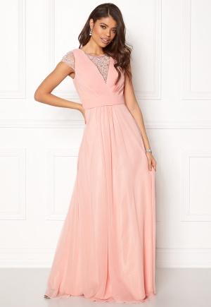 Tidlös rosa klänning med dragkedja i silke.