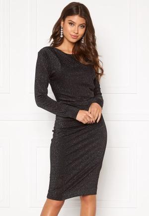 Förtrollande söt svart klänning med dragkedja i stretch.