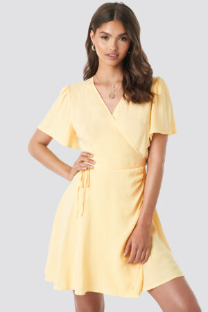 Camille Botten x NA-KD Wrap Mini Dress - Yellow