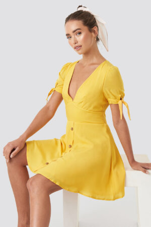 Céline & Talisa x NA-KD Button detail mini dress - Yellow