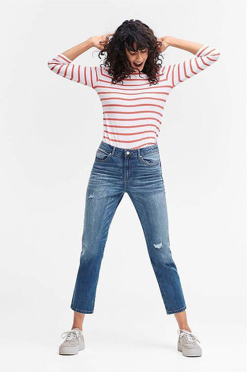 Croppade jeans med slitning