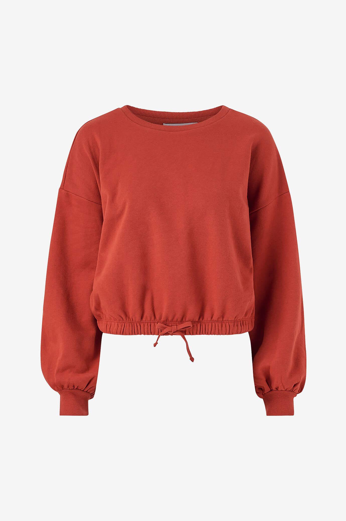 Röd sweatshirt med ballongärmar långärmad med ribbmudd.
