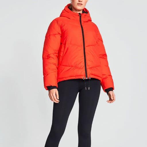 Orange skidjacka dam