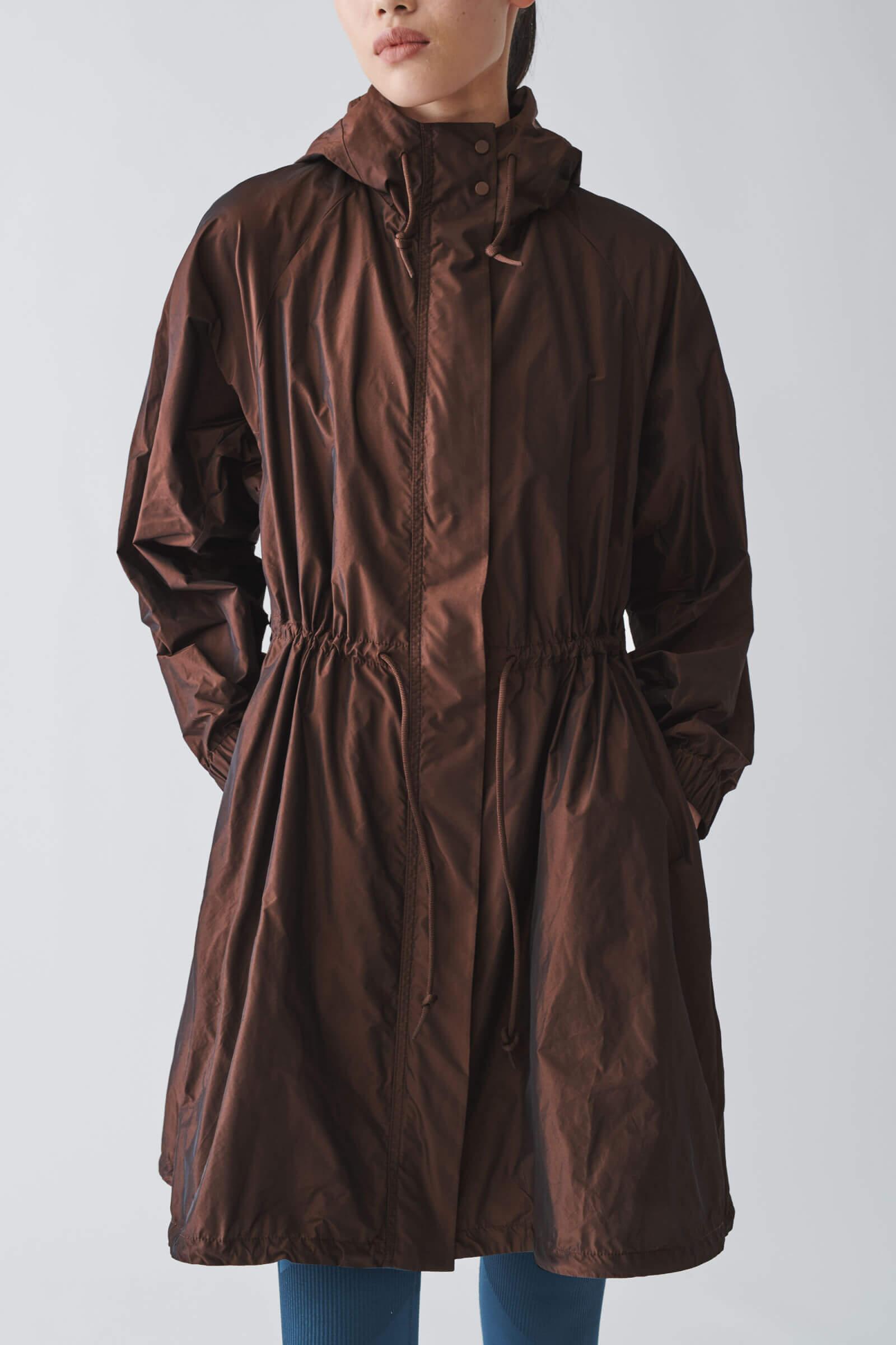 Lång brun jacka dam