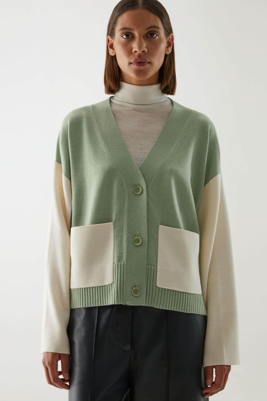 Grön och vit kofta ull