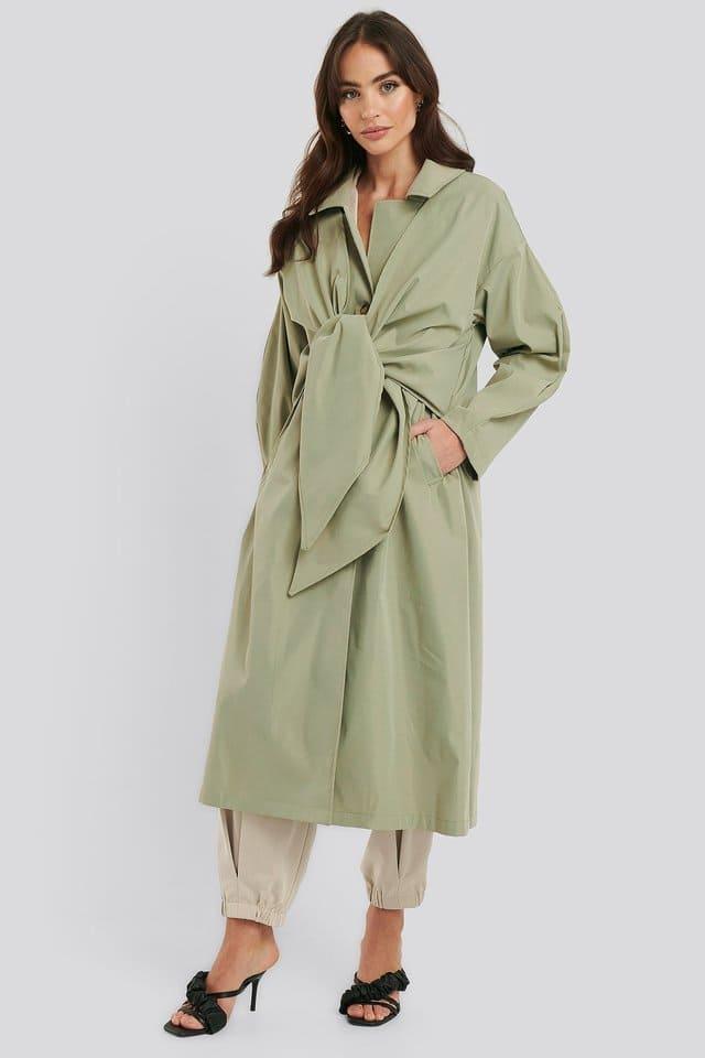 Ljusgrön trenchcoat för dam