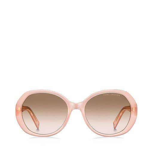 Ljusrosa solglasögon i oversized modell