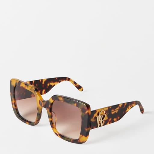 fyrkantiga bruna och oversized solglasögon för dam