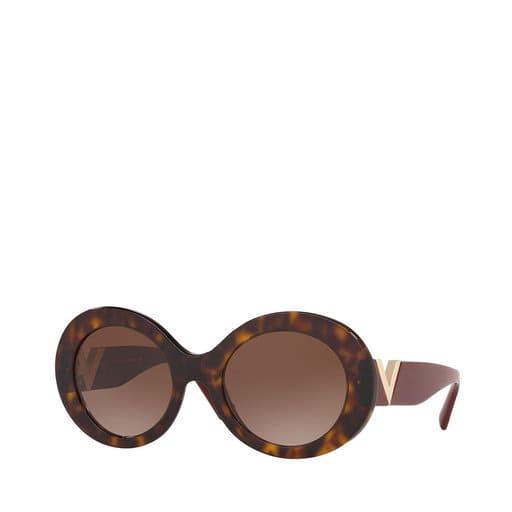 Runda solglasögon i brunaktig färg för dam