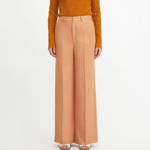 Orangea byxor för dam 2021