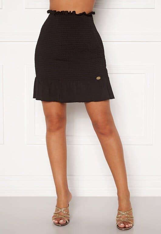 Kort kjol som är tight vid midjan för dam