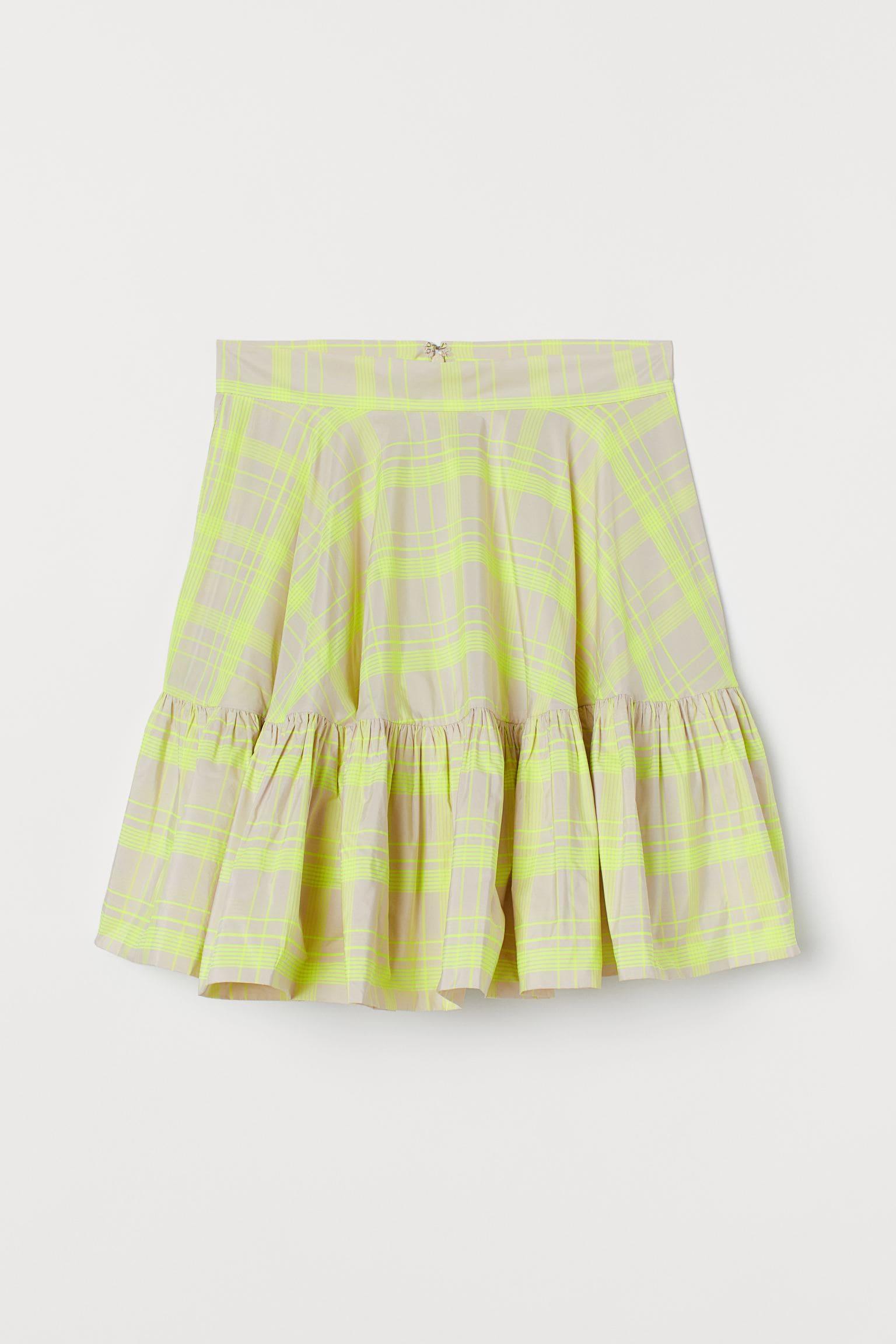 Kort kjol i ljust brun och grön färg 2021