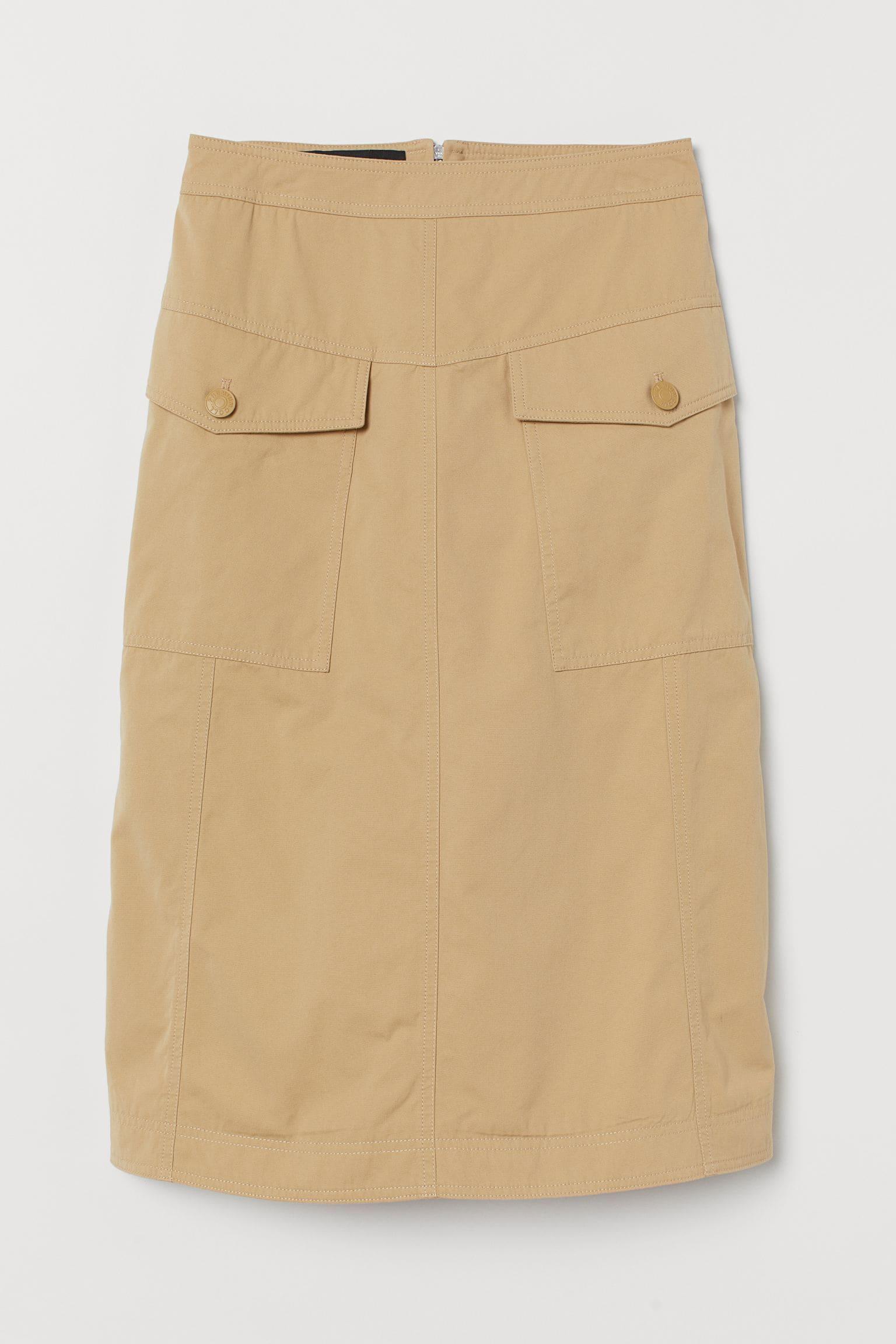 Kjol med fickor i beige färg för dam