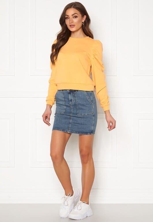 Jeanskjol med stora fickor för dam