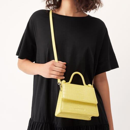 Smidig gul handväska i återvunnet material