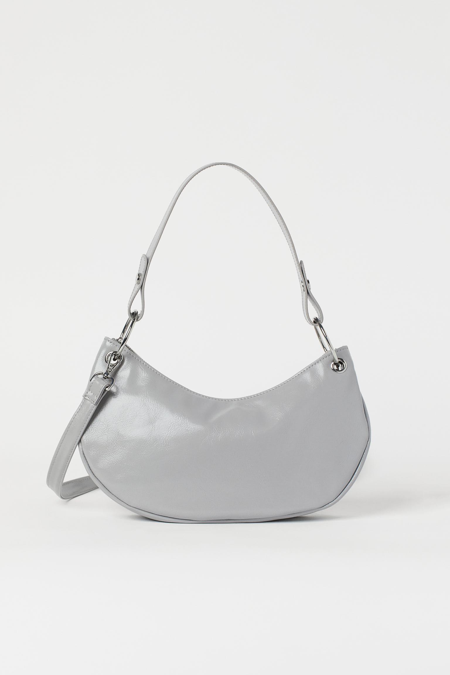 Grå fodrad handväska i läderimitation