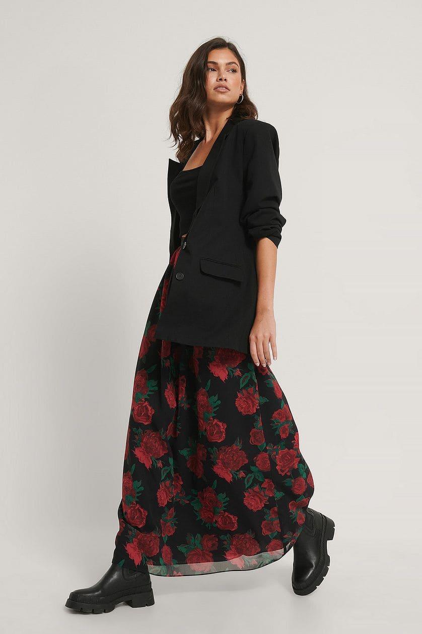 Blommig kjol med flytande passform 2021