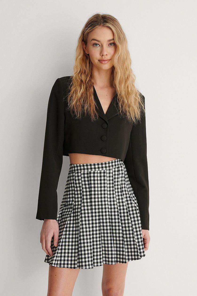 Rutig kjol i svart och vitt för dam 2021
