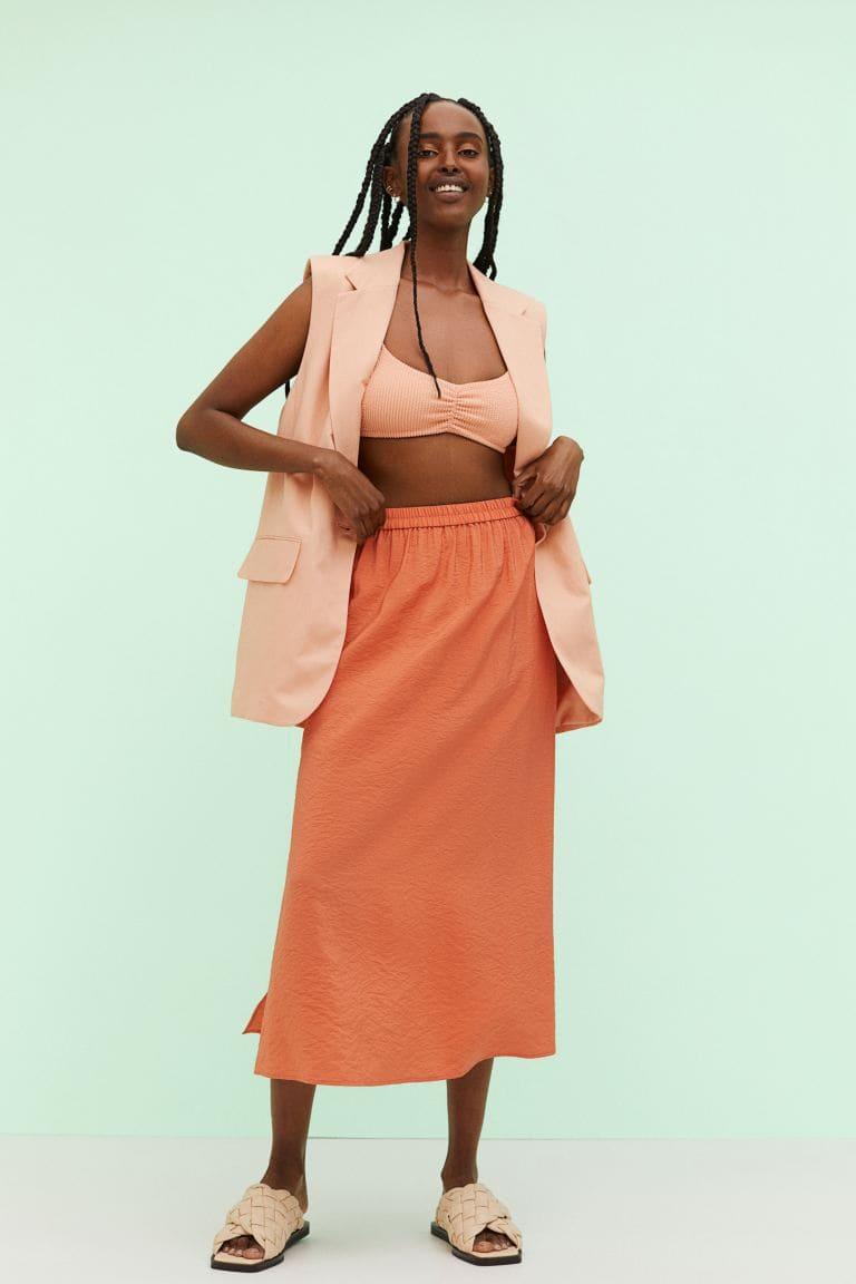 Orange ankellång kjol i vävd kvalitet med hög slits i sidorna