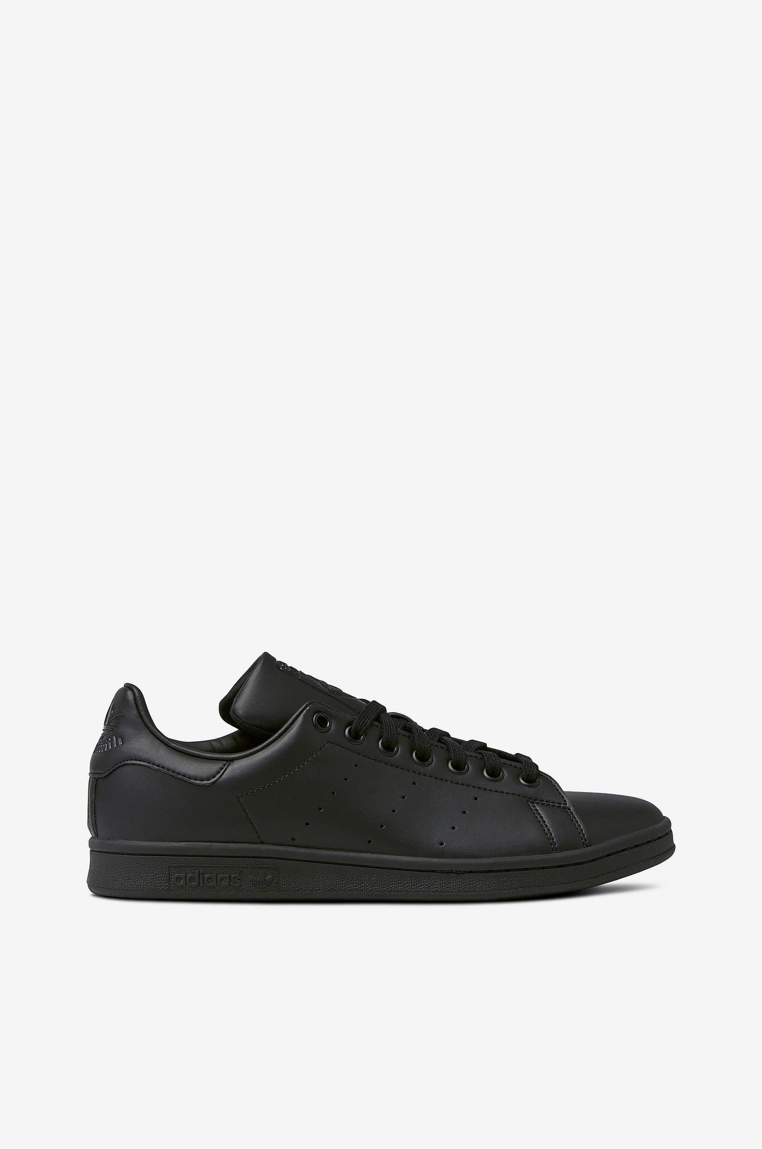 Adidas sneakers i skinnimitation från Stan Smith