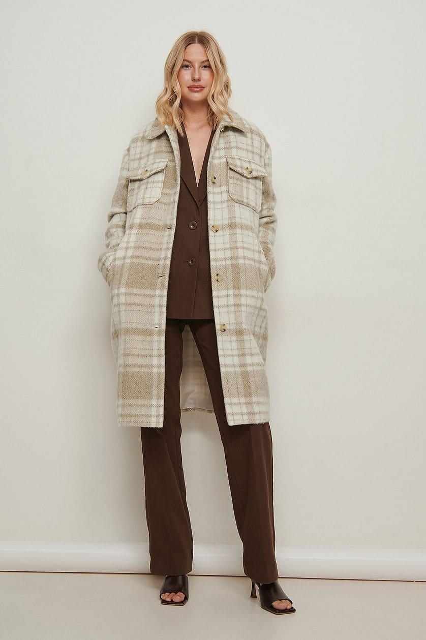 Skjortjacka i rutigt mönster och beige färg