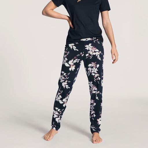 Mörkblå pyjamasbyxor med rosa vita blommor och blad i bomull